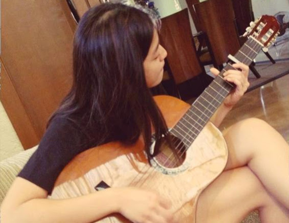 Gretchen playing guitar