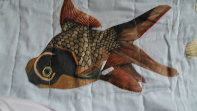 Pond life, young black moor fish hand applique, to be quilted