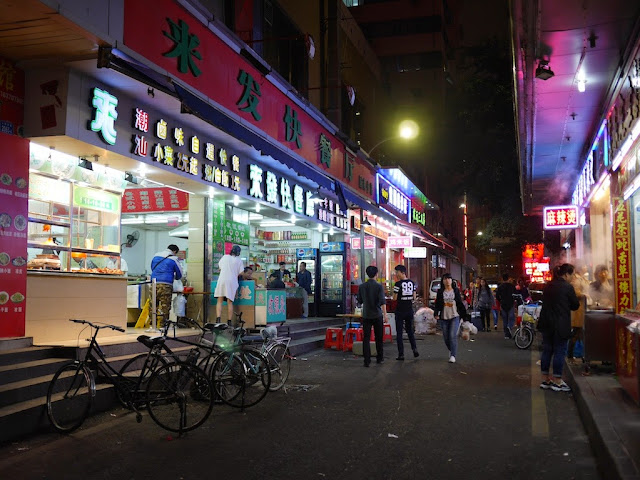 people walking in an alley in Shenzhen