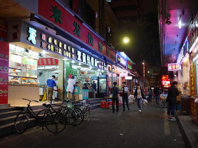 people walking in an alley in Shenzhen