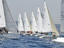 J/80 one-design sailboats- sailing off starting line-
