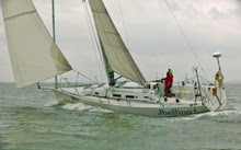J/122 sailing single-handed off Cowes, England on Solent