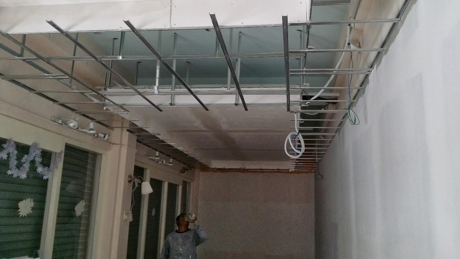 Installing plaster ceiling board