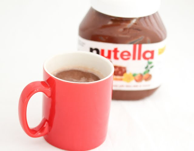 nutella hot chocolate with a jar of nutella in the background