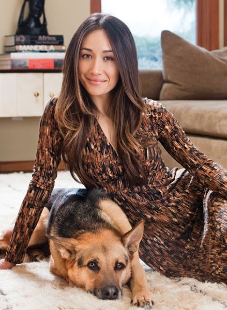 Maggie Q posing with her dog