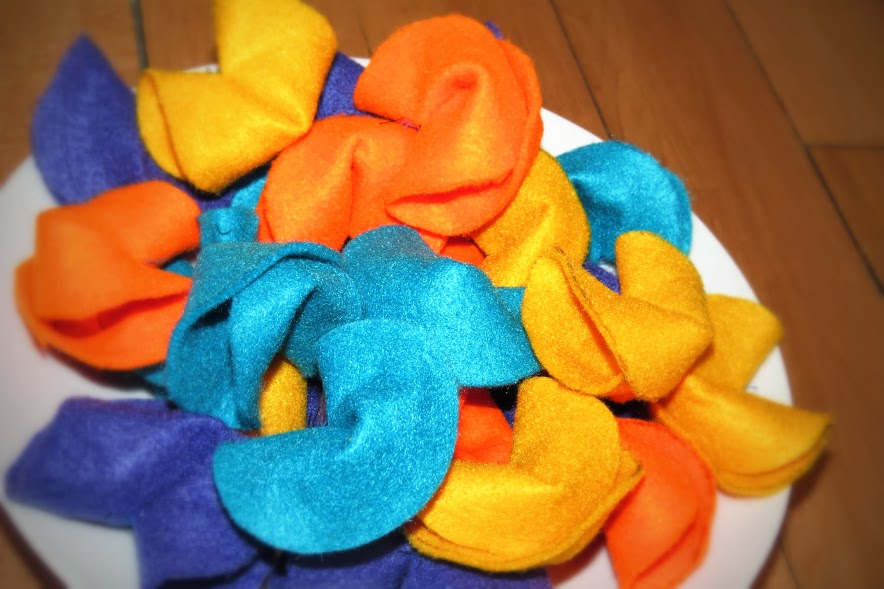 felt fortune cookies piled on a plate