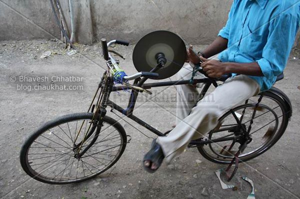 Bicycle with a sharpener mounted
