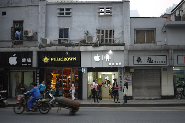 mobile phone store with prominent Apple and Android logs on its sign in Changsha, China