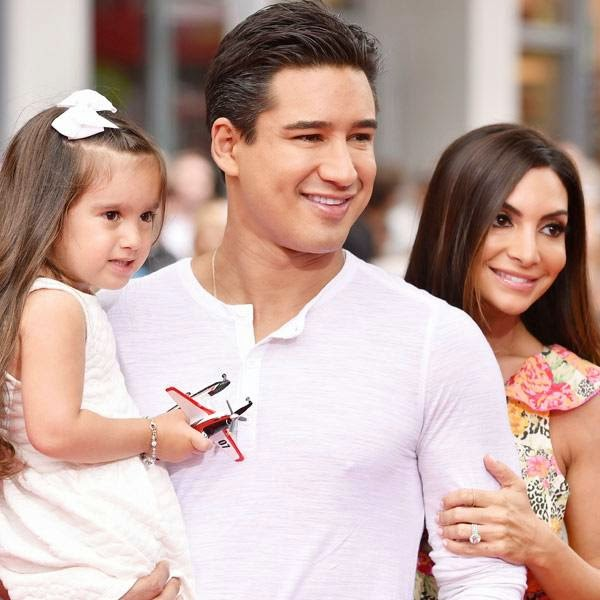 Mario Lopez, center, and from left, Gia Francesca Lopez and Courtney Laine Mazza arrive at the premiere of Disney's Planes: Fire & Rescue sponsored by Coco Joy Kids at El Capitan on Tuesday, July 15, 2014, in Los Angeles.