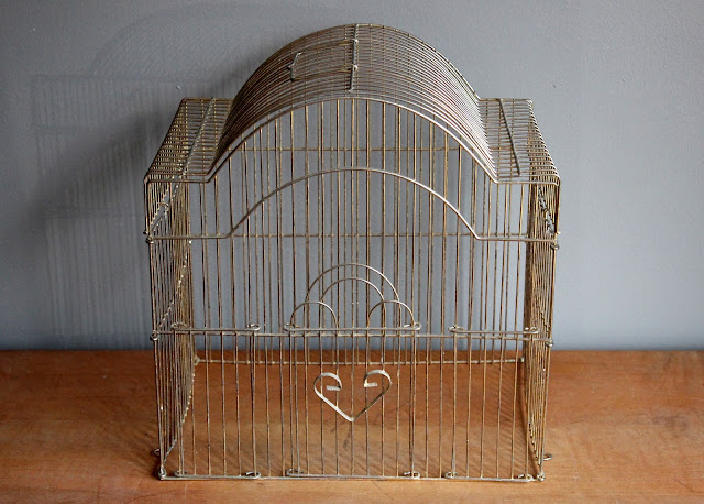 Large metal birdcage available for rent from www.momentarilyyours.com, $2.50.