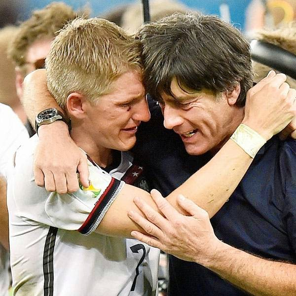 Germany's Bastian Schweinsteiger and Germany's head coach Joachim Loew embrace after the World Cup final soccer match between Germany and Argentina at the Maracana Stadium in Rio de Janeiro, Brazil, Sunday, July 13, 2014.