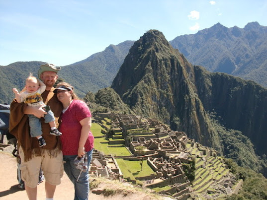family at Lost city of Muchu Picchu, Peru