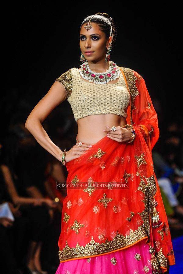 Candice Pinto showcases a creation by Golecha Jewels on Day 3 of India International Jewellery Week (IIJW), 2014, held at Grand Hyatt, in Mumbai.<br /> <br /> <br />