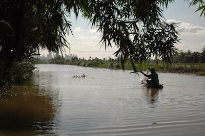 Traditional way of fishing on a small sampan with fishing net