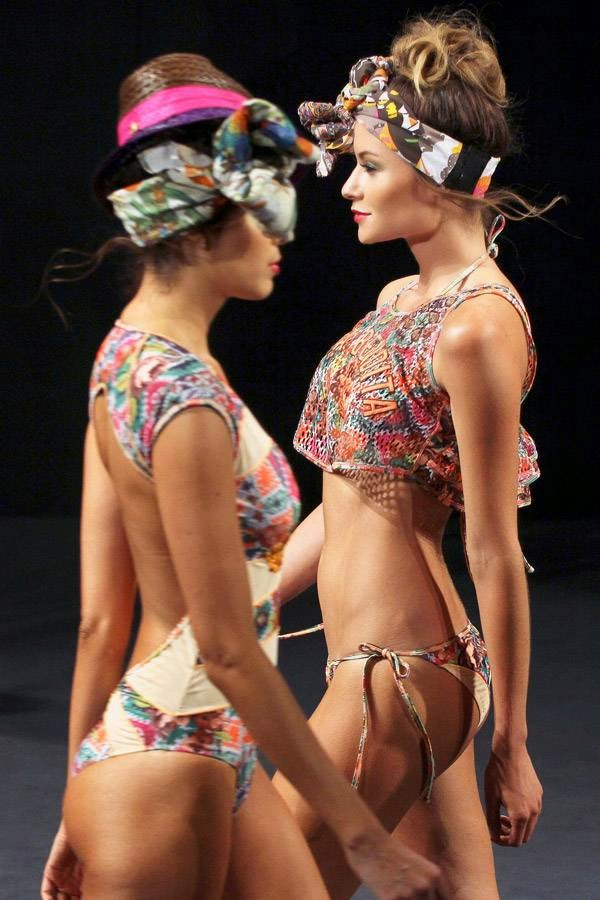 Models present creations from the brand Agua Bendita during Colombiamoda fashion show in Medellin, July 23, 2014.