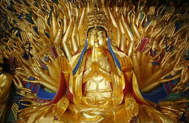 East Asia: 800-year-old Buddhist statue of 'goddess with thousand hands' restored to former glory