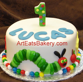 The very hungery caterpiler custom fondant first birthday cake with number 1 topper and the food he ate