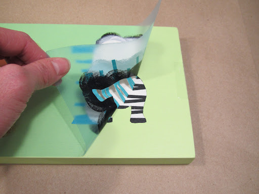The whole stencil and tape can be peeled back at once, when you're finished ...