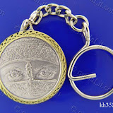 Woman's Eyes With A Niqab. Traditional Arabic impressions. Silver plated minted brass medal 35 mm in diameter.