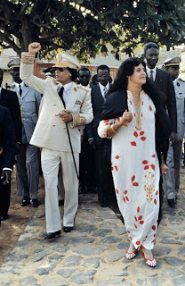 Libyan Head of State Colonel Moamer Kadhafi (L) and his wife Suffiya (R) wave to the crowd 03 December 1985 in Dakar