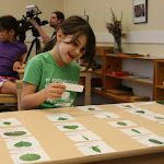 Younger preschoolers learn scientific terms orally; older ones learn to read them as well, like this girl who labels the Botany Cabinet leaf shapes with their names.