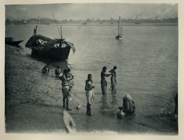 People Bathing and Washing in the River