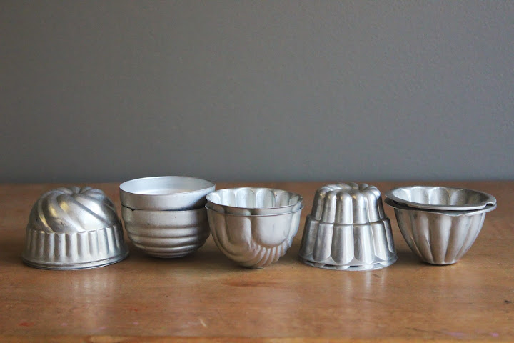 Assorted tin mold votive holders available for rent from www.momentarilyyours.com, $0.75.