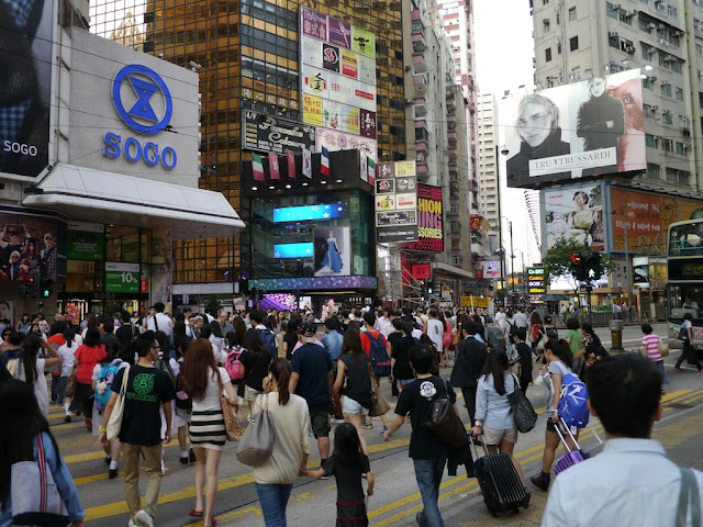 People crossing Hennessy Road in Causeway Bay, Hong Kong