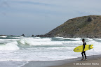 A surfer watching tides at Pacifica State Beach