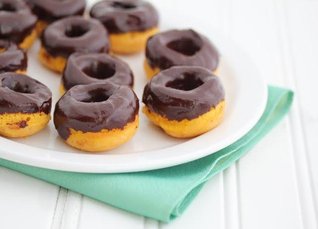 Mini pumpkin donuts with chocolate glaze