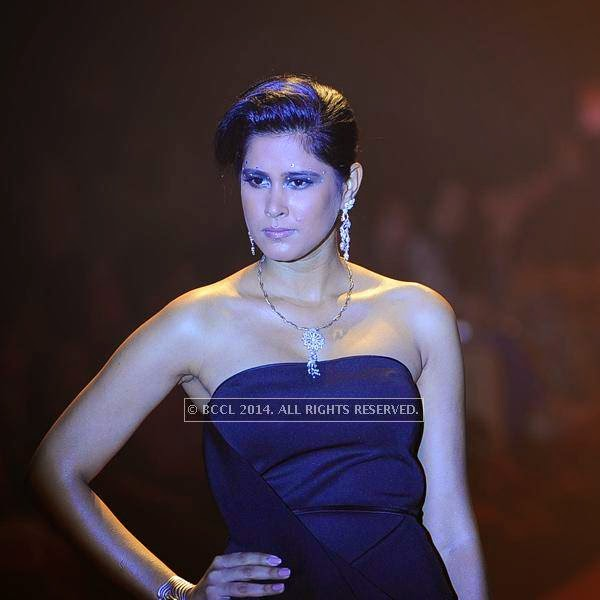 A model walks the ramp for Emerald on Day 3 of India International Jewellery Week (IIJW), 2014 at Grand Hyatt, Mumbai.