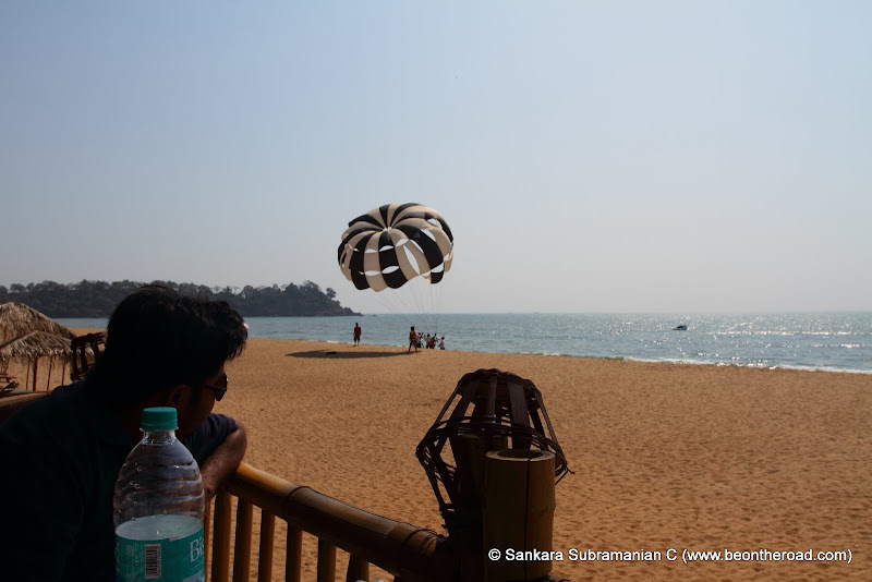 Enjoying the parasailing show at Rajbaga Beach