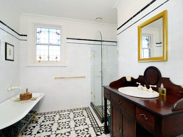 Original Federation style bathroom with modern shower and tap ware and no loo yet.
