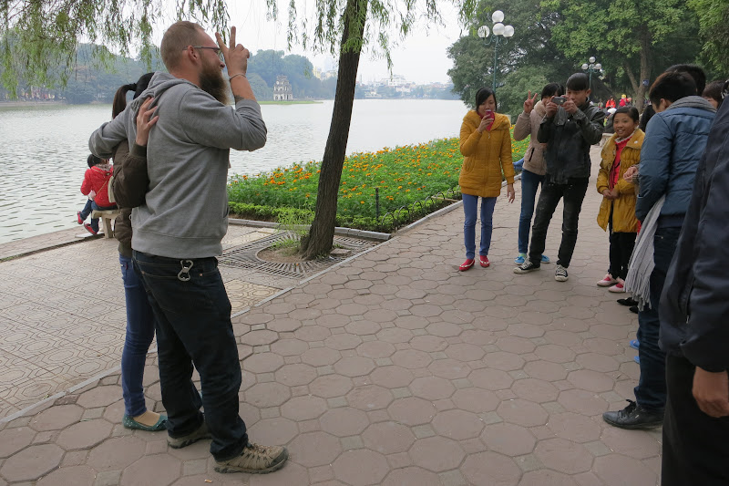 Tony posing for photos at Hoàn Kiếm lake