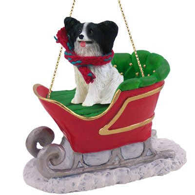 PAPILLON Dog Black rides on a SLEIGH Christmas Ornament NEW Resin SLD47B