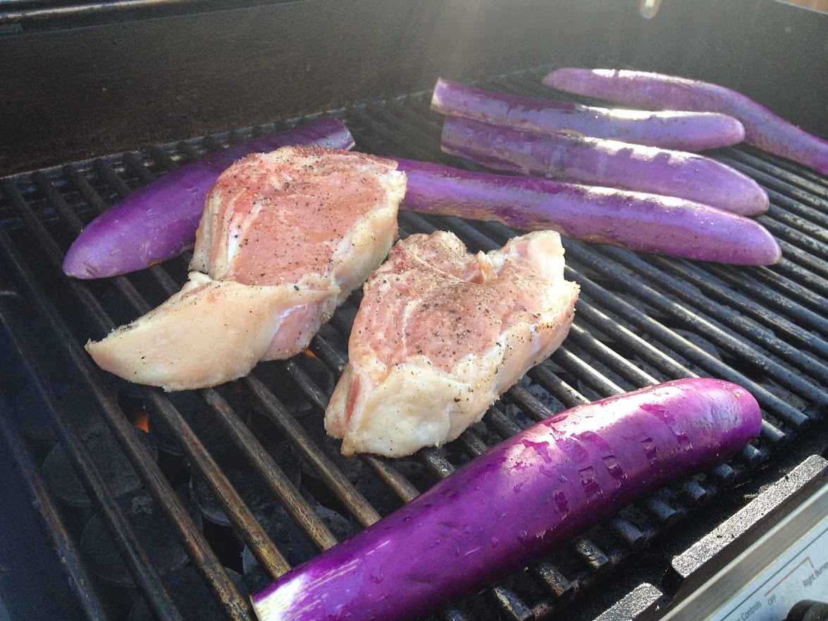 Grilled veal chops are easy to prepare on an outdoor grill and feature Kosher salt and freshly cracked black pepper with eggplant as a side dish