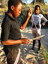 This boy, Matimba, also a member of our host family, is pretty good at English and he was a HUGE help with gathering all the 7th graders for taking pictures of their yearbook topics around the village.