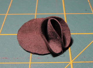 gluing petal on leather circle