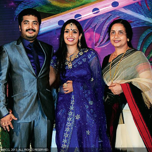Vinu Mohan, Vidya and Sobha Mohan during their wedding reception held in Kerala.