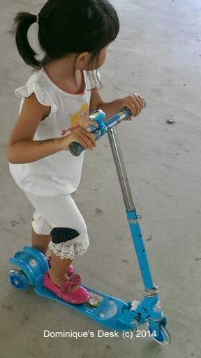 Tiger girl on her Skate scooter
