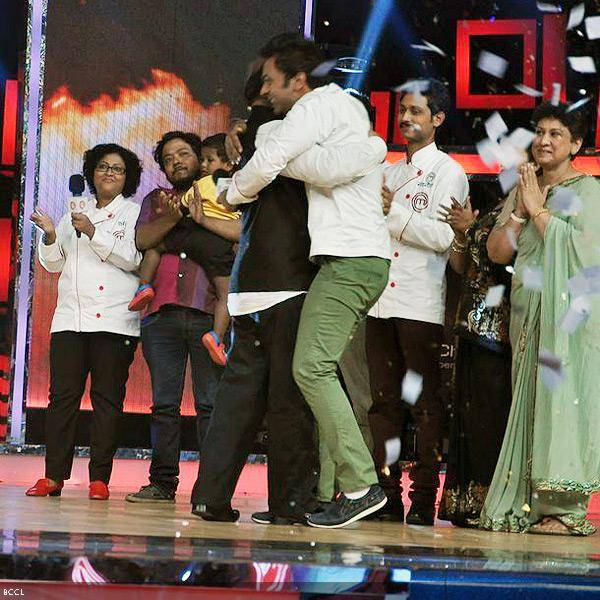 Ripu Daman Handa gets a warm hug from his father after he was announced as the winner during the grand finale of the cookery show Master Chef Season 3, held in Mumbai. (Pic: Viral Bhayani)