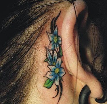 flower tattoo behind ears