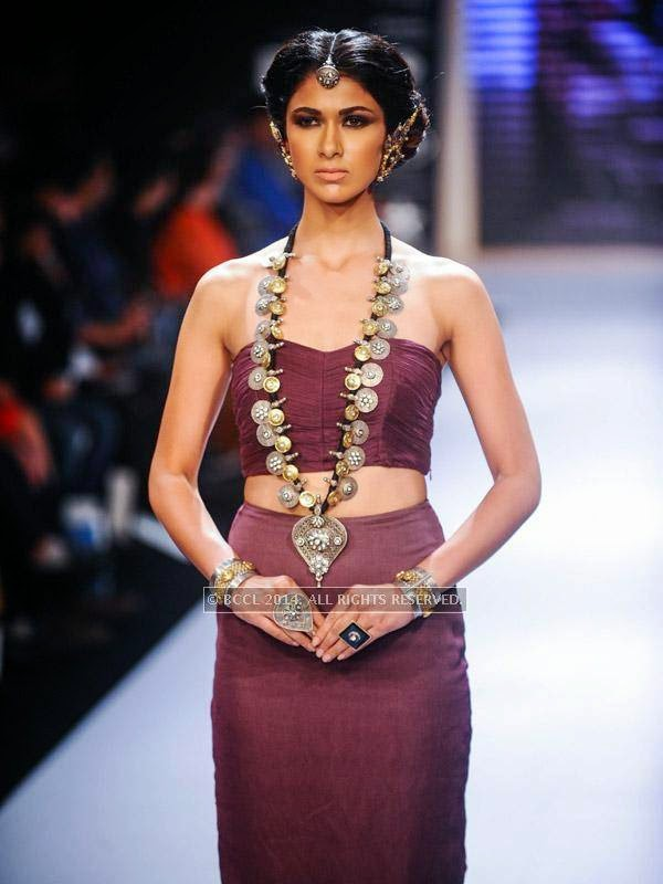 A model walks for Apala by Sumit on Day 1 of India International Jewellery Week (IIJW), 2014 at Grand Hyatt, Mumbai.
