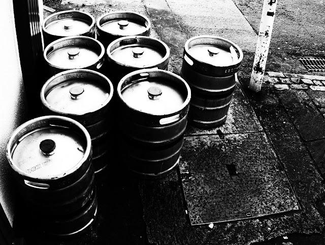 Kegs of beer set up like bowling pins outside a pub in Westport, Ireland.