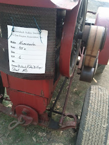 Closeup of a homemade farm tractor, powered by a stationary engine