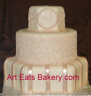 Custom round and hexagon ivory and champagne monogram and lace fondant wedding cake design