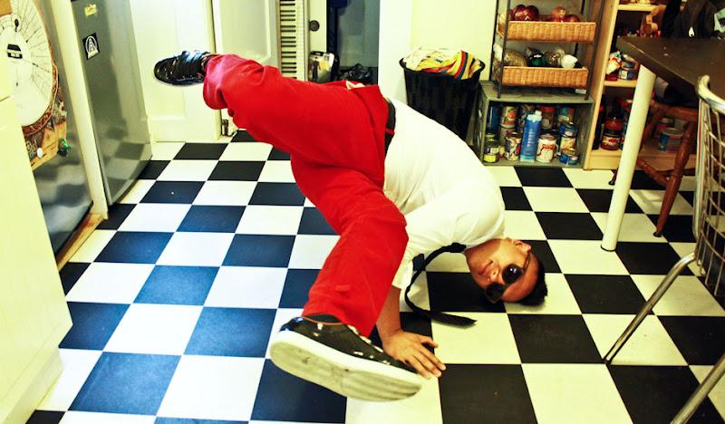 Red Cordarounds Break Dance on checkered floor