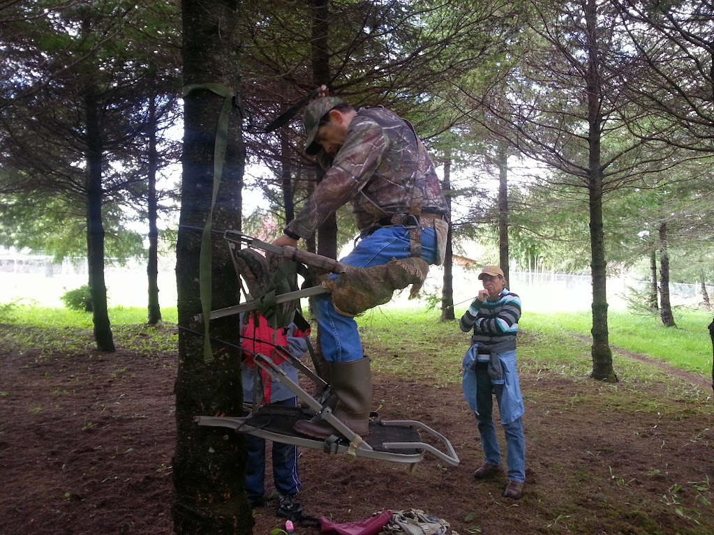 Teaching the use of a climber style treestand.