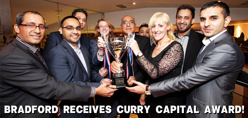 Bradford City receives Curry Capital trophy at the Akbar's Cafe