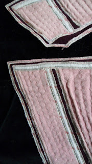 Fanart, Graffiti machine appliqué throw. Close up of stitching on pink letters